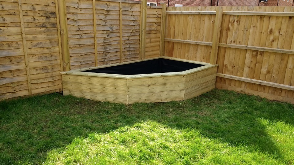 Raised bed constructed out of decking boards